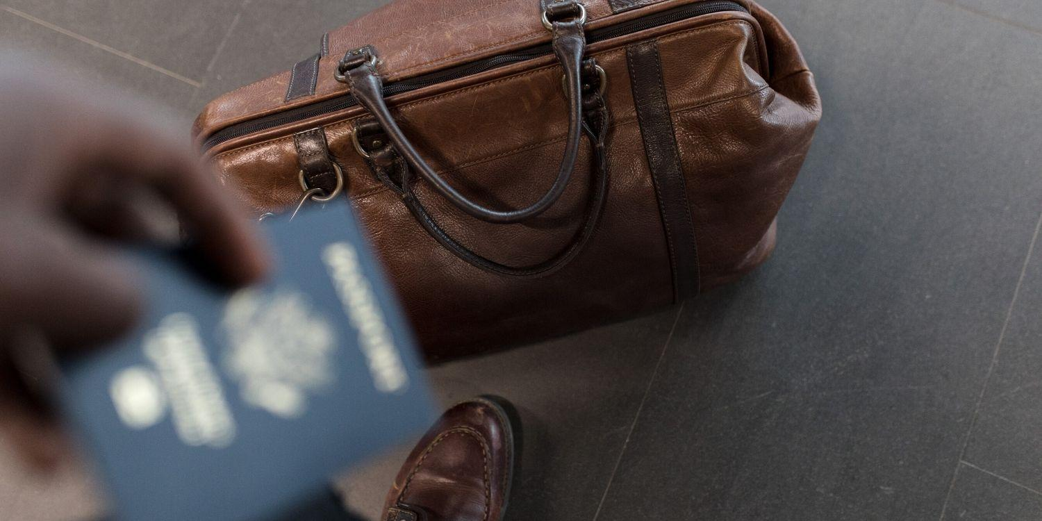 hand luggage and out of focus passport