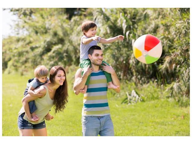 family_playing_with_a_beach_ball