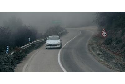 Peugeot_driving_up_winding_road