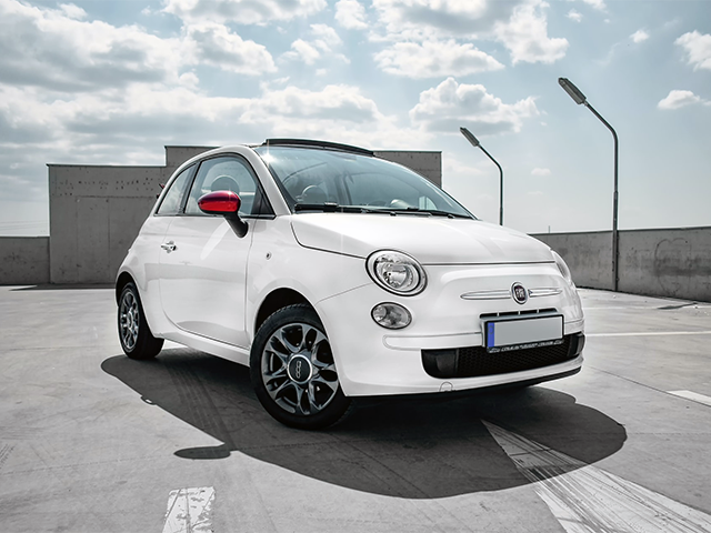 parked_fiat_500_on_top_of_a_multi_story_car_park